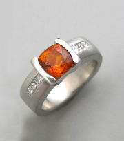 Other Rings 1-3: Cushion cut orange sapphire with channel set princess cut diamonds in white gold