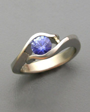 Other Rings 1-4: Round cut blue sapphire partial bezel set in white gold