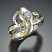 Other Rings 1-7: Platinum and 24k yellow gold snake with round clear and yellow diamonds