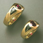 Other Rings 2-7: His and Hers rings with oval synthetic rubies and an inlay of Gneiss; a metamorphic rock over 2.4 billion years old