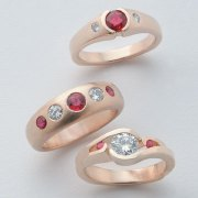 Other Rings 3-1: Three rings with rubies and diamonds in yellow gold