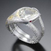 Other Rings 3-12: Pear shaped diamond as the head of the snake with ruby eyes set in platinum with yellow gold details