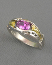Other Rings 3-8: Oval pink sapphire set with small diamonds and Calla Lily details in platinum and yellow gold