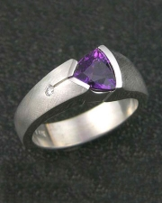 Other Rings 2-10: Triangular cut purple sapphire partial bezel set in white gold