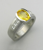 Other Rings 2-9: Oval cut yellow sapphire partial bezel set with princess cut diamonds on the sides in platinum