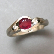 Other Rings 3-7: Round cut ruby partial bezel set with small diamonds in white gold