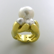Other Rings 1-5: Octopus setting for a pearl in yellow gold