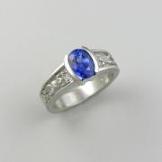Other Rings 3-9: Oval blue sapphire partial bezel set with frogs down the sides in white gold