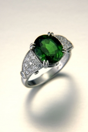 Other Rings 3-3: Oval green tsavorite in prongs with pave set diamonds in platinum