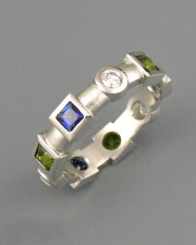 Bands 1-6: Princess cut blue and synthetic green sapphires with round cut diamonds in platinum