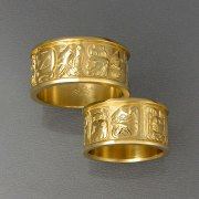 Bands 1-7: His and Hers bands with Mayan symbols in yellow gold