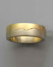 Bands 2-11: Two toned band in yellow and white gold with a random wave pattern