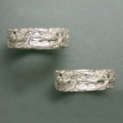 Bands 2-5: Juniper trees with a mountain background in white gold