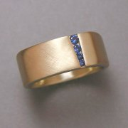 Bands 2-9: Small blue sapphires in a squared style yellow gold band