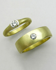 Bands 3-1: His and Hers engagement ring and wedding band with round cut diamonds in platinum and yellow gold