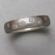 Bands 1-2: Small full cut diamonds flush set in a scattered pattern in white gold