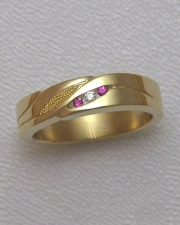 Bands 1-9: Small round rubies and diamond in 14karat yellow gold