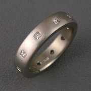 Bands 2-10: Princess cut diamonds flush set around a platinum band