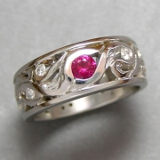 Bands 2-3: White gold band designed from an old family piece with a ruby and diamonds