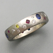 Bands 3-12: Various shaped flush set clear and yellow diamonds, rubies and blue sapphires in platinum
