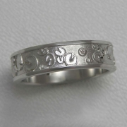 Bands 3-2: Lily pads with small diamonds in white gold