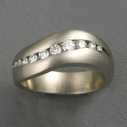 Bands 3-6: Curved band with channel set diamonds in platinum
