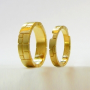 Bands 1-1: 18kt. yellow gold custom matching bands with stone motif (two bands key into each other)