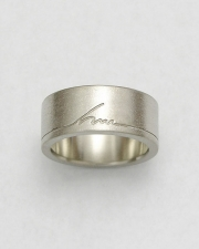 Bands 1-3: 14kt. white gold custom initial ring