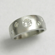 Bands 1-5: 14kt. white gold band with flush set round diamonds