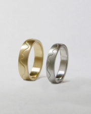 Bands 1-12: 14kt. yellow and white gold custom bands with curved center line