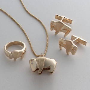 14kt. Yellow Gold Buffalo ring, extra large Buffalo pendant with diamond eyes and Buffalo cufflinks