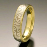 Mokeme Gane Star pattern in 14kt. White Gold and silver set in an 18kt. Yellow Gold lining with narrow rails, slightly domed band style