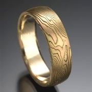Mokeme Gane etched Classic pattern in 18kt. Yellow Gold and 14kt. Red Gold set in an 18kt. Yellow Gold lining, slightly domed band style