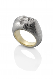 Carved Damascus Stainless Steel Vulcana face with 18k Yellow gold. Collaboration between Chris Ploof and Anthony Lent