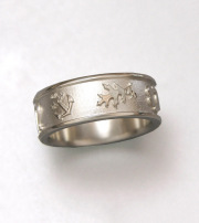 14kt. white gold band with Oak leaf and other symbols