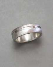 14k White gold line hammered band with off set recessed channel