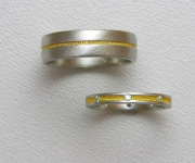 Pair of Platinum bands with 24k Inlay, small Diamonds