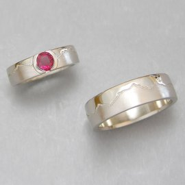 Mountain Bands 1-12: 14-karat white gold skyline ruby engagement ring and matching wedding band