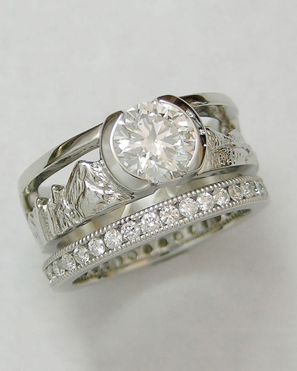 Mountain Engagement Rings 1-1: Platinum diamond Boulder Peaks ring with channel set miligrain eternity band