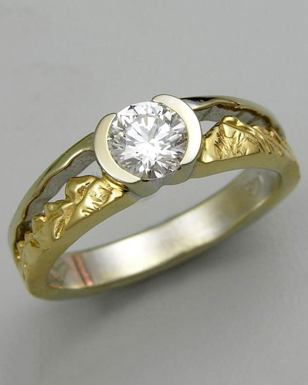 Mountain Engagement Rings 1-12: 14kt. yellow and white gold two-tone Twin Peaks engagement ring with a partially bezel set round diamond in the center