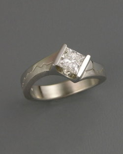 Mountain Engagement Rings 1-10: Platinum Skyline ring with a .70carat princess cut diamond in an off-set channel