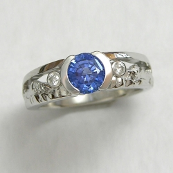 Mountain Engagement Rings 1-9: Platinum mountain ring with sapphire in partial bezel and a bezel set diamond on each side