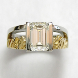 Mountain Engagement Rings 1-3: Platinum and 18kt. Emerald cut diamond ring featuring the Boulder Peaks and Twin Peaks