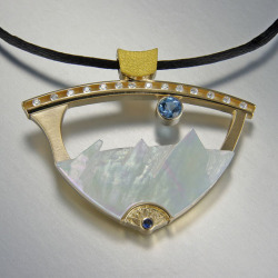 14kt. and 24kt. yellow gold mother-of- pearl flatirons pendant with sapphires and diamonds