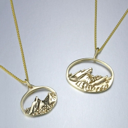 14kt. yellow gold charm size and standard oval Flatirons pendants