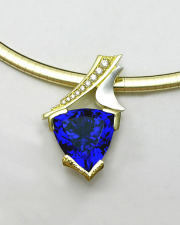 Necklace 1-8: Triangular tanzanite with bead set diamonds set in 18k yellow gold