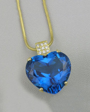 Necklace 2-11: Tanzanite heart with bead set diamonds in yellow gold