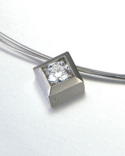 Necklace 2-5: Round cut diamond prong set in a square frame in white gold