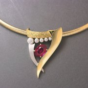 Necklace 2-6: Oval ruby in prongs with full bezel set diamonds in white and yellow gold