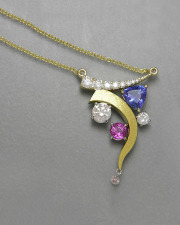 Necklace 2-8: Necklace with various shaped and colored stones in white and yellow gold